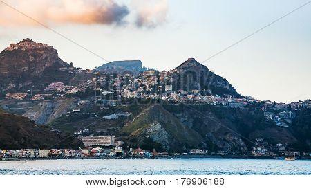 Taormina City And Giardini Naxos Town In Evening