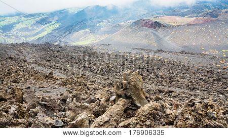 Cloud On Frozen Lava Field On Mount Etna