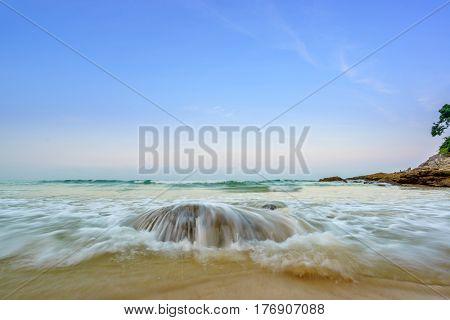 Surin beach at sunrise in Phuket island Thailand