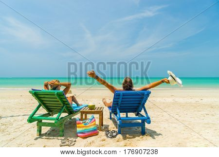 Couple on the beach at tropical resort Travel concept