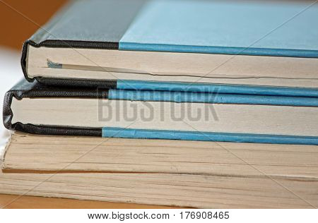 Closeup of a Stack of Books on a Desk