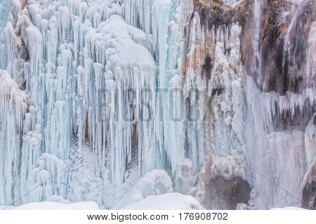 Frozen waterfall in winter time at Plitvice lakes in Croatia.