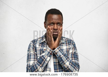 Portrait Of Scared Young African American Man With Toothache Having Frustrated Frightened Look, Touc