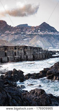 Stone Breakwater In Giardini Naxos Town