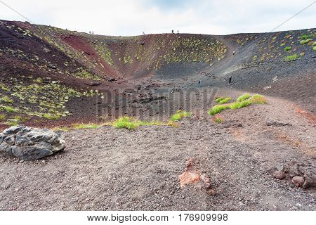 Tourists In Old Crater On Mount Etna In Sicily