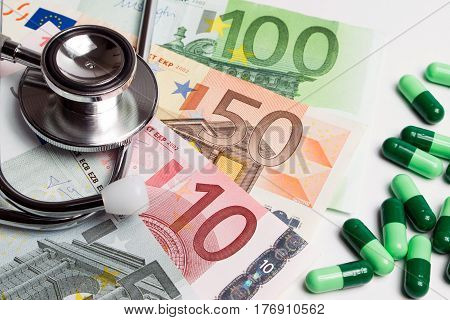 Pills Medicine Or Medicine Capsule And Doctor Stethoscope On Euro Money. Medical And Money For Socia