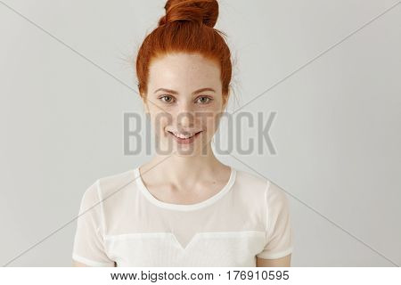Portrait Of Attractive Redhead Girl With Freckles Looking At Camera And Smiling Happily. Beautiful Y