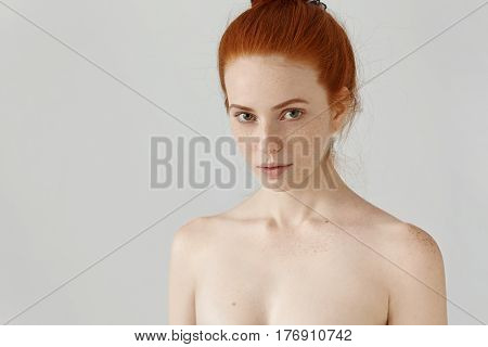Close Up View Of Head And Shoulders Of Amazing Redhead Young Woman With Freckles Posing Naked Agains