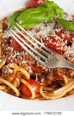 closeup of silver fork on spaghetti bolognese