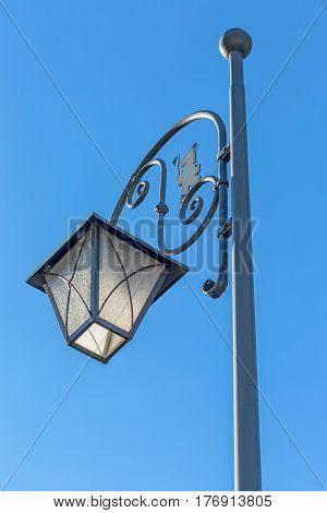 Antique street lamp design on day light in Sappada Italy.
