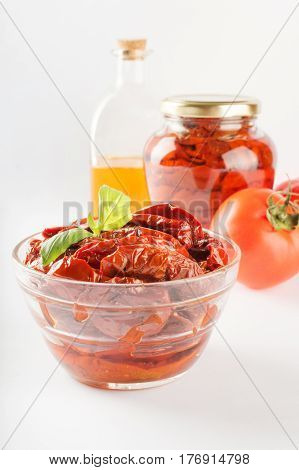 Italian appetizer - sundried tomato in bowl and glass jar.