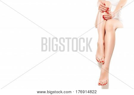 Beautiful well-groomed woman with red manicure, sitting at banner, isolated on white background
