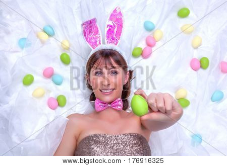 smiling woman holding easter eggs