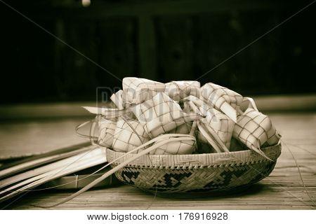 black and white image of basket of keputat