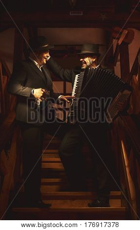 Two Musicians On Staircase