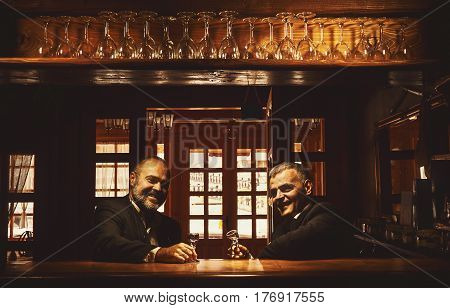 Two Men Smiling In Bar