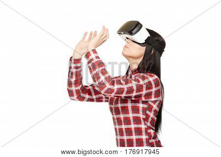 Studio portrait of woman in modern VR headset traveling in cyberspace and playing in basketball. Female in glasses of virtual reality playing sport game and holding arms up. Studio isolate.