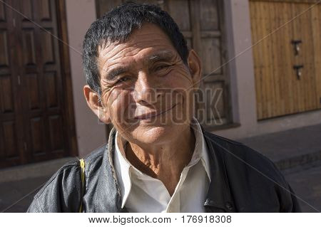 SAN CRISTOBAL DE LAS CASAS CHIAPAS MEXICO - FEBRUARY 19 2017: Distinct indigenous features and smiling faces are characteristic of the friendly inhabitants of this mountainous community in Chiapas Mexico