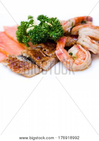 Fish platter marinated shrimp smoked eel Chum salmon on white background.