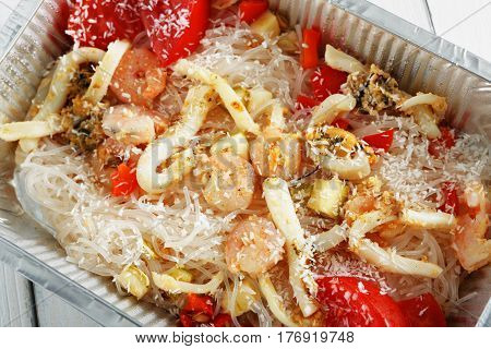 Healthy food closeup background. Take away of natural organic food in foil boxes. Fitness nutrition, rice vermicelli