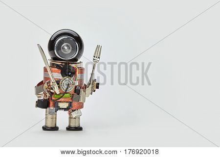 Cooking kitchen chef character with fork and knife in arms. Food menu concept with friendly robot, black helmet electric wires transistors on gray background copy space