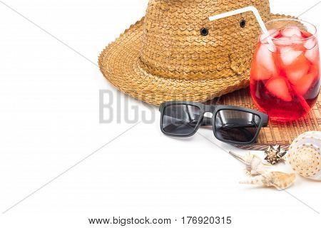 Hat with glasses, red cocktail and seashells on white background Summer holiday concept Free space for text
