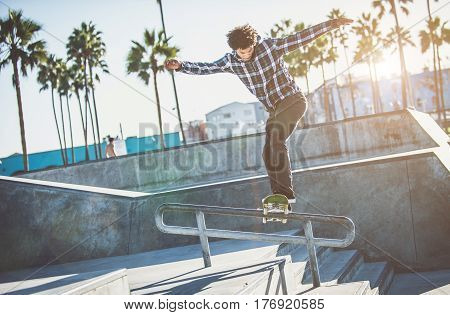 Skater in action in Los angeles performing tricks