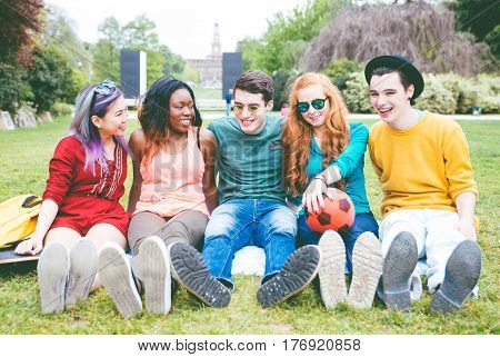 Group of friends laughing out loud outdoor sharing good and positive mood.