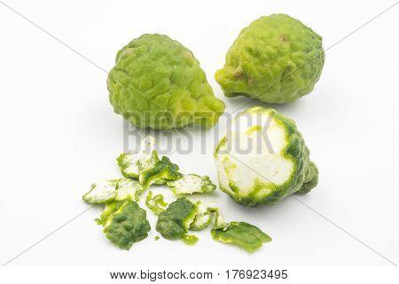 Sliced skin bergamot or kaffir lime on white background.