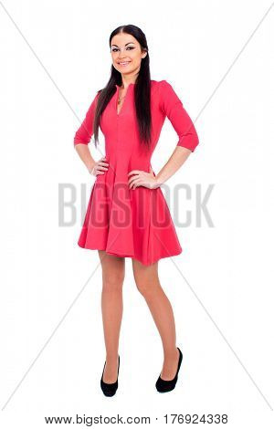 Portrait in full growth the young beautiful woman in a vinous knitted dress, isolated on white background