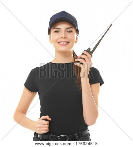 Beautiful young woman in security uniform on white background