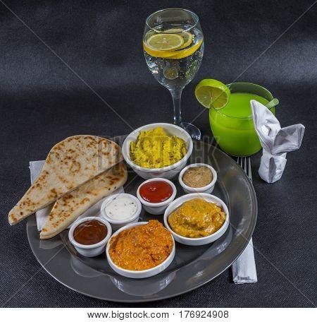 Oriental Indian Set, Chicken Korma, Chicken Tikka Masala, Pilau Rice, Naan Bread, Four Sauces, Gray
