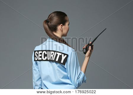 Beautiful security guard on grey background