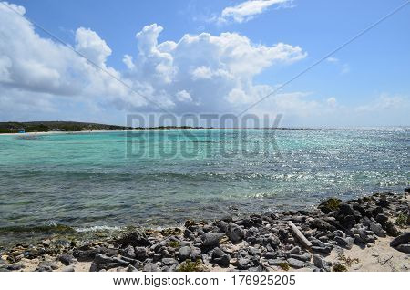 Clear crystal waters of Baby Beach in Aruba perfect cove for snorkeling.