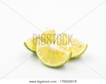 Limes with slices on a white background