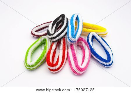 Closeup to Pile of Fabric Hair Elastic on White Background/ isolated