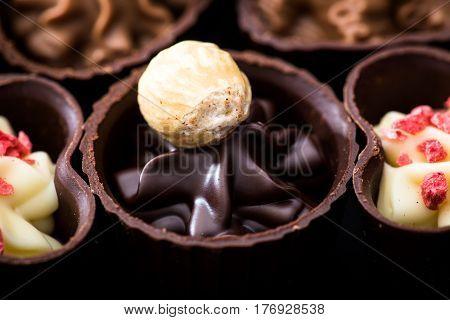 Different Kinds Of Chocolates Close-up. Various Chocolate Pralines