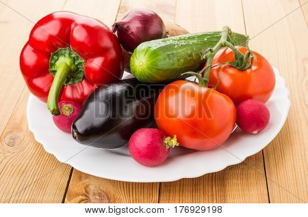 Different Vegetables In Glass Dish On Table