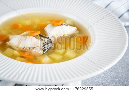 Fresh Fish Soup With Pike Perch And Vegetables In A White Plate