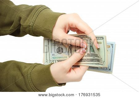 woman hands hold an counting us dollar banknotes isolated on the white background. manicured french nails