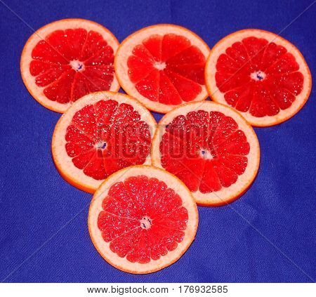 Grapefruit. Bright red and juicy this fruit is very useful vitamin. A very good friend to the health and the figure of a man