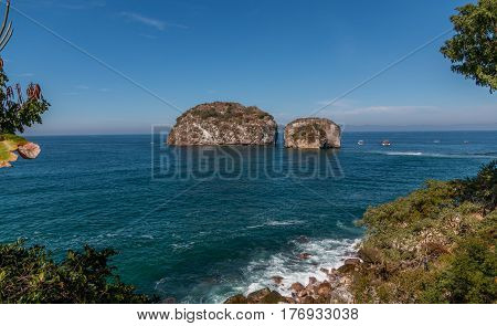 Los Arcos islands , south of Puerta Vallarta Mexico , are a popular snorkeling destination for tourists.