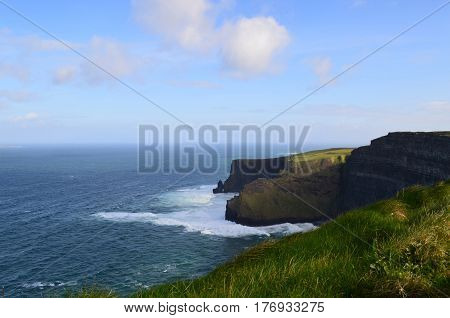 Rollicking waves at the base of the Cliff's of Moher in Ireland.