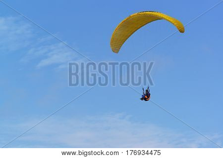 Anapa district Krasnodar Krai Russia - August 15.2015: Paragliding - non-powered manned aircraft with soft wing which is inflated via the air intakes RAM air on background blue sky
