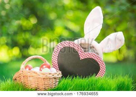 Easter Bunny And Eggs On Green Grass