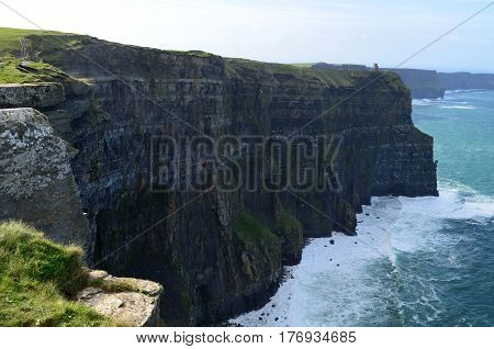 Extremely steep sea cliffs known as the Cliff's of Moher.
