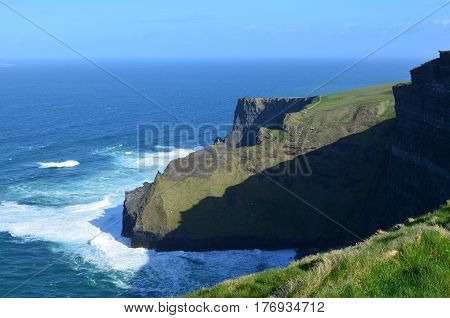 Beautiful look at grass growing along the sea cliffs in Ireland.