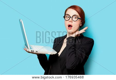 Beautiful Surprised Young Woman With Laptop On The Wonderful Blue Background