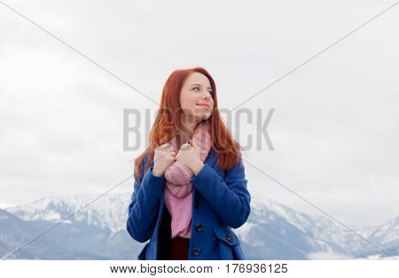 Beautiful Young Woman On The Mountains Background
