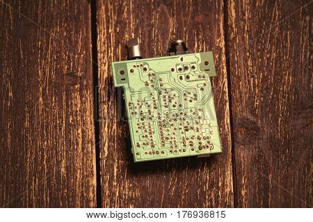Photo Of Cool Small Modern Microchip On The Wooden Brown Background